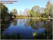 Freizeitgrundstück mit Teich und Wald