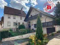 Schönes Einfamilienwohnhaus und sanierungsbedürftiges Dreifamilienhaus