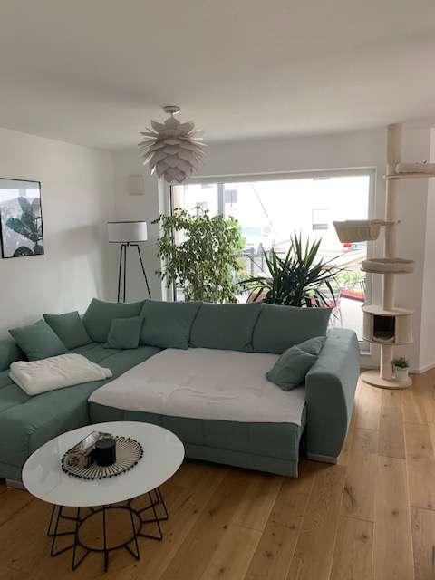 Helle 3-Zimmer-Wohnung mit Terrasse, Garten u. Garage in