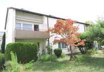 Zweifamilien-Doppelhaushälfte in durchgrünter Umgebung - in