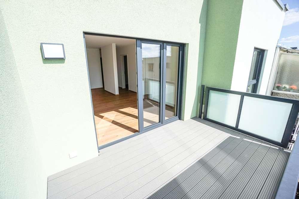 Neubau Erstbezug: hochwertig ausgestattete 2-Zi.-Whg. mit gr. Balkon, EBK und Tageslichtbad in