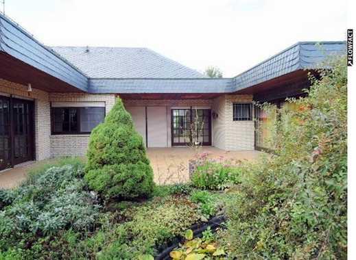 Toller Bungalow auf ca. 380 m² Wohnfläche mit 9 Zimmern, EBK, Garten, Kachelofen und Garage!