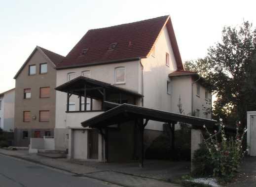 Dreifamilienhaus / Doppelcarport / Garagen