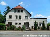 Wohn- und Geschäftshaus mit 9