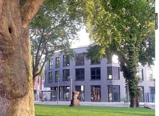 NEUWERTIGES, RENDITESTARK vermietetes Bürogebäude mit diversen Ladenlokalen in TOPLAGE