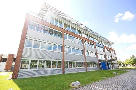 Hausansicht von Neue Mitte | Bürofläche im Erdgeschoss an der Centroallee!