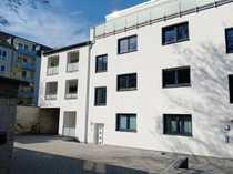 1 Exklusive Innenhof Neubauwohnung mit