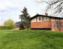 Denkmalgeschütztes Gebäude mit Bauland