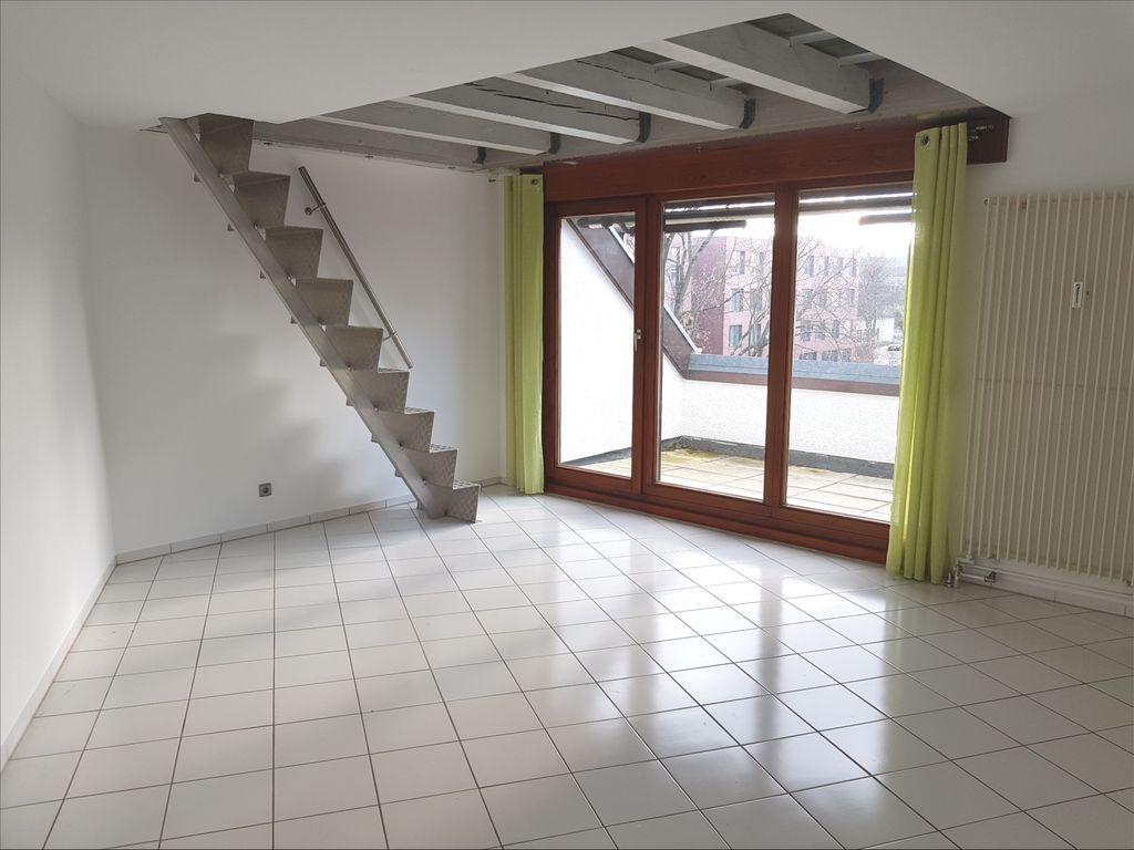Wohnzimmer mit Treppe zum 2.DG