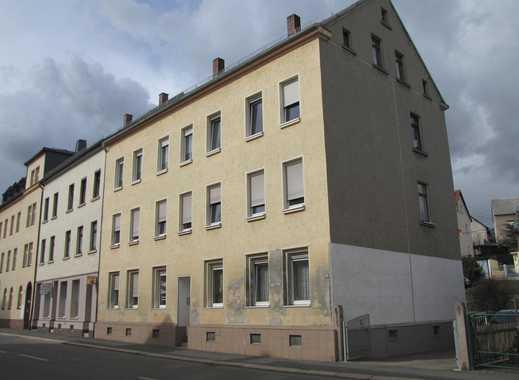Sanierungsbedürftiges Mehrfamilienhaus