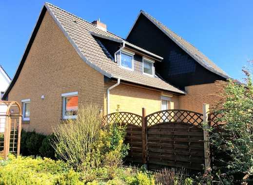 Doppeltes Wohnglück: zwei gepflegte Wohneinheiten mit Garage und Wintergarten