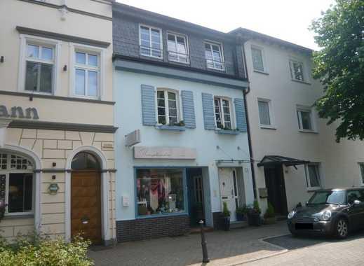 Haan-Gruiten. Geschmackvoll modernisiertes Wohnhaus mit kleiner Boutique in bevorzugter Lage!