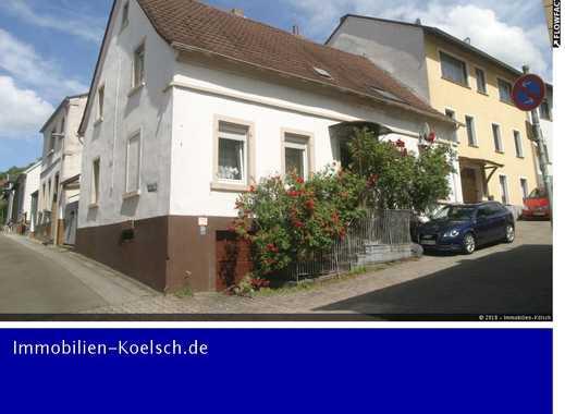 Zentral und dennoch ruhig gelegen: Ein-/Zweifamilienhaus mit Hof