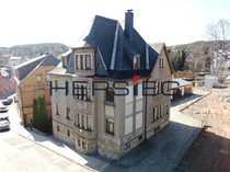 Attraktives Mehrfamilienhaus mit Garagenkomplex