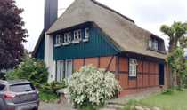 Reetdachhaus mit Seeblick