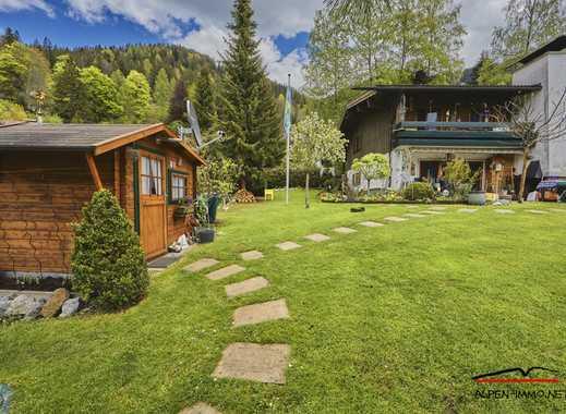 ATTRAKTIVE DOPPELHAUSHÄLFTE mit wunderschönem Garten und Bergblick