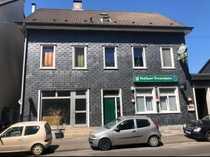 Sanierungsbedürftiges Mehrfamilienhaus mit 6 Wohneinheiten