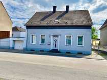 Vermietetes Einfamilienhaus mit zwei Wohneinheiten