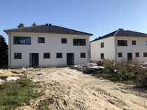 Doppelhaushälfte mit Carport