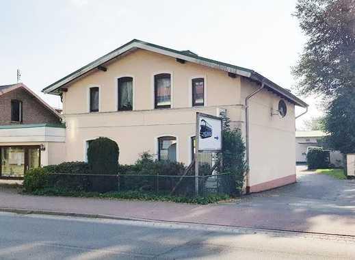 Zentral gelegenes Wohnhaus mit großflächigem Gewerbeteil auf 2.296 m² Grundstück