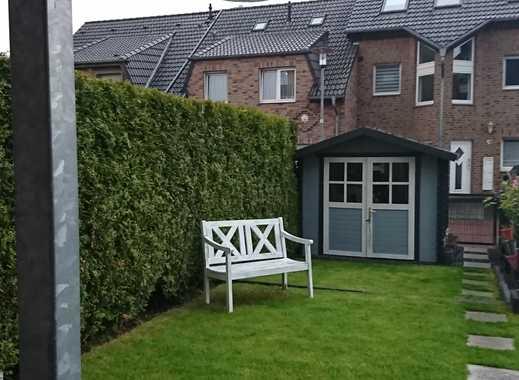 Freundliche 4-Zimmer-Erdgeschosswohnung mit Garten in Grevenbroich