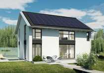 Haus mit sonnigem Baugrundstück