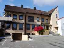 Gewerbeimmobilie mit Büroflächen und Wohnungen