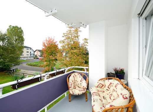 Helle & Moderne 3 Zimmer Wohnung im Erdgeschoss mit Balkon.