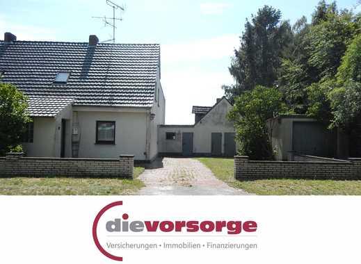 Renovierungsbedürftige Doppelhaushälfte mit Garage in Barenburg zu verkaufen!