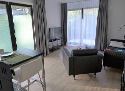 Pfiffige  2 Zimmer Terrassenwohnung mit Einbauküche -voll Möbliert- im Neubaustandard!