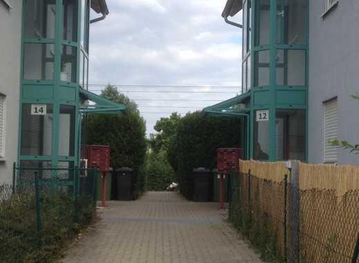 Gemütliche 1 Zi.-ETW mit Einbauküche, Terrasse, Garten u. Tiefgaragenstellplatz