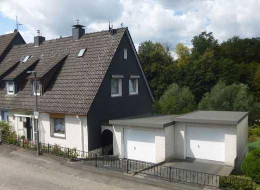 Heiligenhaus!  Gepflegte Doppelhaushälfte in ruhiger Lage mit Garten und zwei Garagen