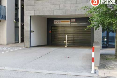 Großzügiger Tiefgaragenparkplatz in moderener heller Tiefgarage