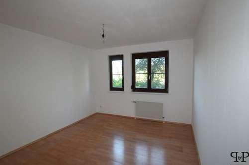 >>> Eigentumswohnung mit Garten und Tiefgaragenplatz
