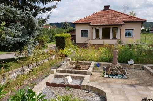 Einfamilienhaus - mit weitläufigen Garten - und zusätzliches Baugrundstück