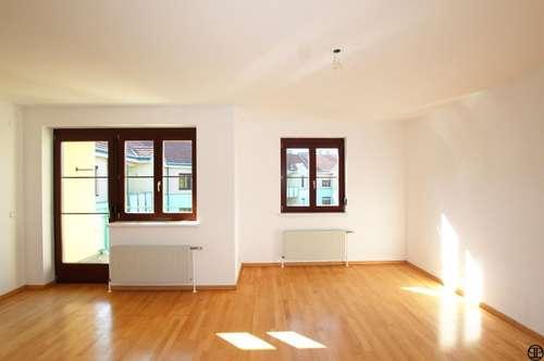 PAUL & Partner: Eigentumswohnung mit Garten und Tiefgaragenplatz