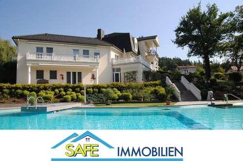 Velden am Wörthersee: Exklusive Villa mit lagunenartigem Pool in ruhiger, sonniger Lage.