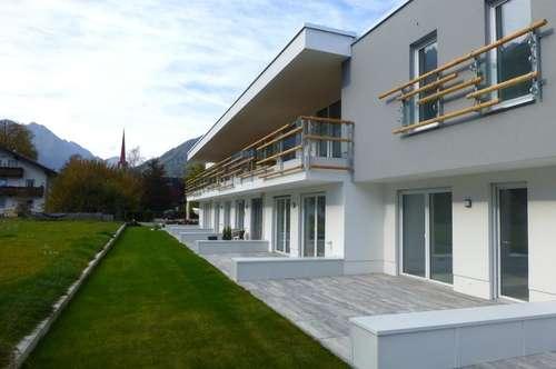 Gartenwohnung mit Reihenhaus-Charakter und TG-Platz - Neubau