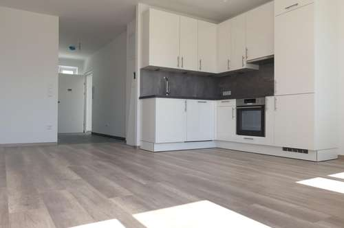 Optimal geplante 3 - Zimmer Erstbezug WHG inkl. EWE Küche, Garten & KFZ Stellplatz in Michelhausen