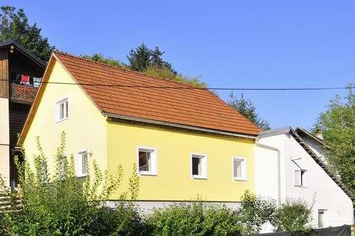 Einfamilienhaus mit Keller, Garage und kleinem Garten!