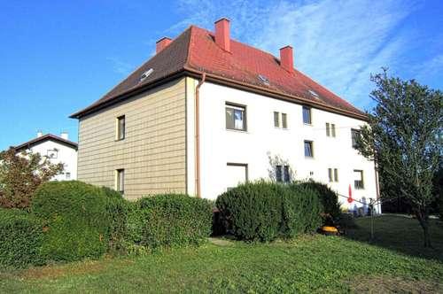 gemütliche, ruhige 3 Zimmer Eigentumswohnung mit Balkon, Garten, Kellerabteil, Garage und Zimmer im Dachgeschoss