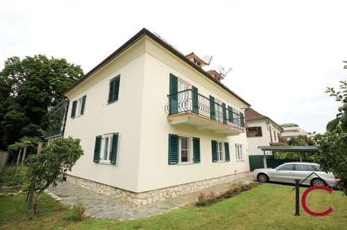Großzügige Erdgeschosswohnung mit schönem Gartenbereich und Carport in Zweifamilienhaus