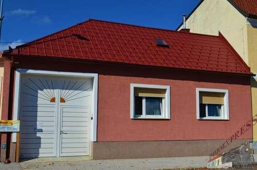 Einfamilienhaus mit großem Grund im Zentrum