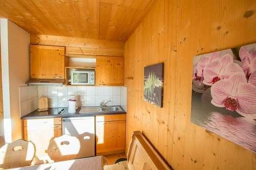 ein gemütliches Holzblock-Ferienhaus - mit der Kombination Vermietung und Eigennutzung - in schöner Naturlage