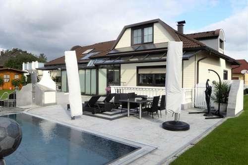 Wohnen auf höchsten Niveau - luxuriös ausgestattete Villa mit Pool und Wellnessbereich in ruhiger Siedlungslage zum Top-Preis