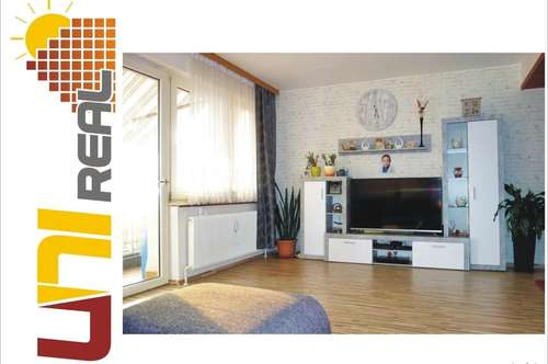 - UNI-Real - Charmante Wohnung mit sonnigem Balkon!
