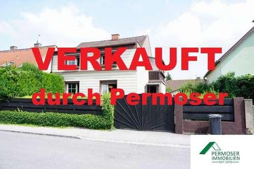 sanierungsbedürftiges Siedlungshaus mit Garage in sehr guter Lage