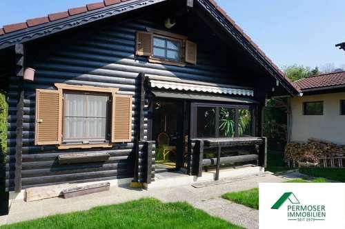 gepflegtes Holzblockhaus mit Garage