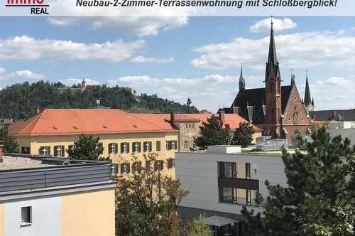 Neubauschmuckstück! 2-Zimmer-Terrassenwohnung mit 13m² Terrasse und Schloßbergblick!