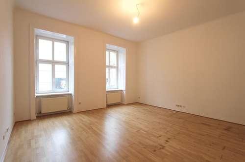 Nähe Rochusplatz! Südwestseitiger 2-Zimmer-Altbau im Hochparterre
